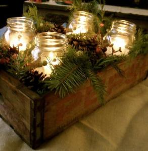 canldes in glass jars in decorated box